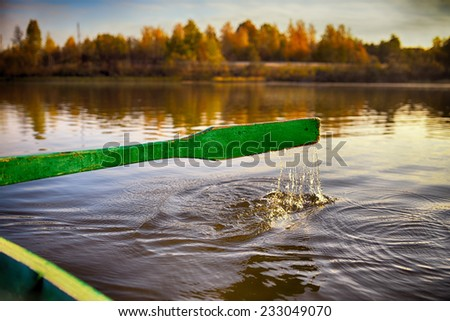 Oar on rowing boats in Russian district floats to the coast - stock photo