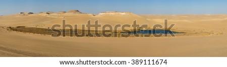 Oasis in Sahara desert in Egypt, blue lake in desert big size panorama - stock photo
