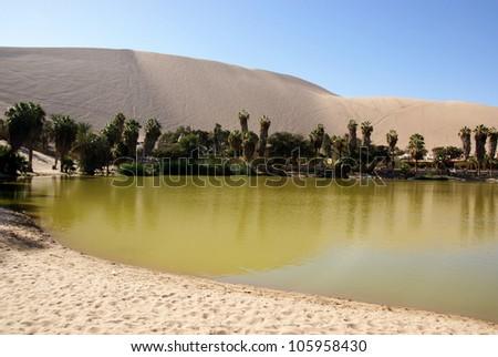 Oasis of Huacachina in Atacama desert, Peru - stock photo