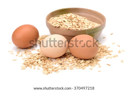 Oat and eggs on white background - stock photo