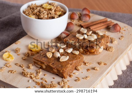 oat bar on wooden board, close-up - stock photo