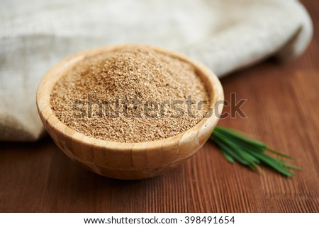 oat bran in bowl on wooden table/ diet food - stock photo
