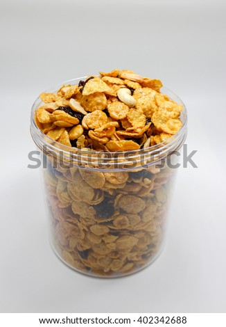 oat cereal with raisin and nut in plastic package on white - stock photo