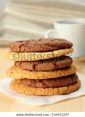 Oat cookies and Chocolate cookies with a cup on background
