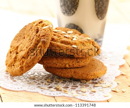 oat cookies biscuits and a glass of milk - stock photo