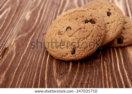 oat cookies on wooden table - stock photo