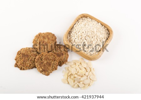 Oat Cookies with ingredients on a white background - stock photo