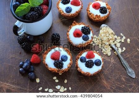 Oat cookies with light yogurt and fresh fruits - stock photo