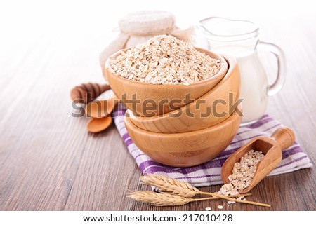 oat flake, bowl of cereals - stock photo