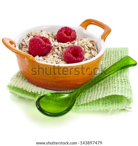 oat flake porridge  in clay casserole dish with fresh berries , diet concept isolated on white background