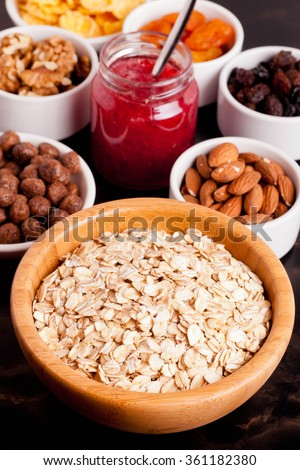 oat flakes and various delicious ingredients for breakfast, close up