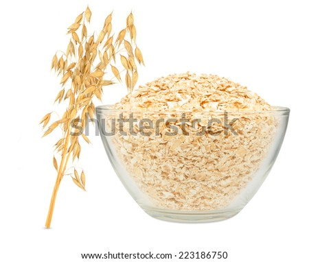 oat flakes in a bowl on a white background  - stock photo
