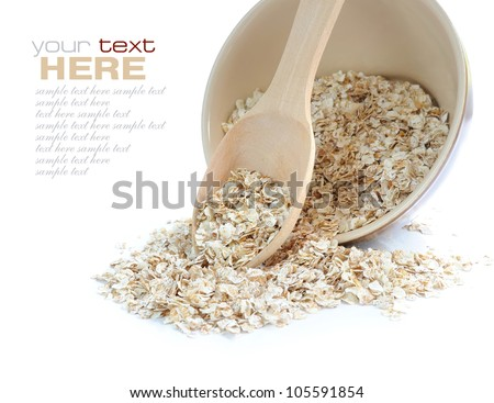 Oat flakes in bowl and wooden spoon on white background - stock photo