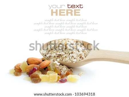 Oat flakes in wooden spoon with mix nuts and dry fruits on white background - stock photo