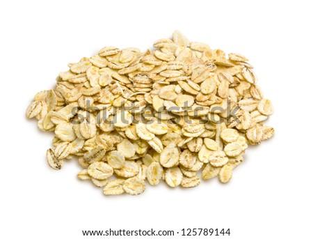 Oat flakes on white background - stock photo