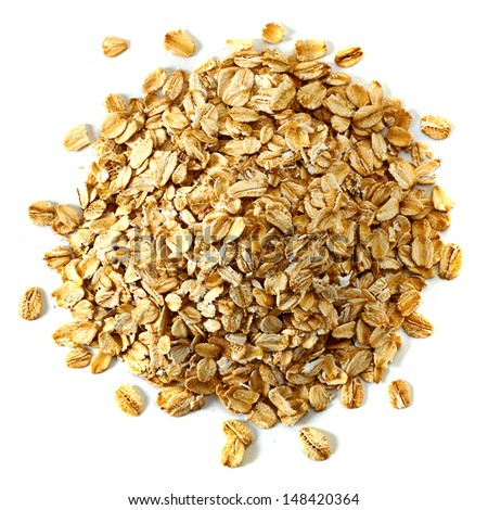 Oat flakes pile from top on white background - stock photo
