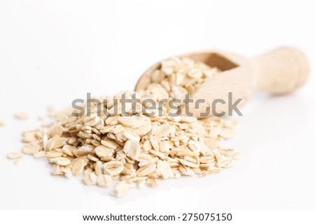 Oat flakes pile on white background - stock photo