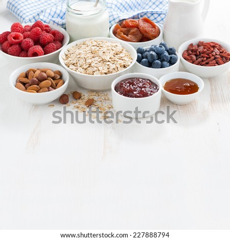 oat flakes, various ingredients for breakfast on wooden background and place for your text,  - stock photo