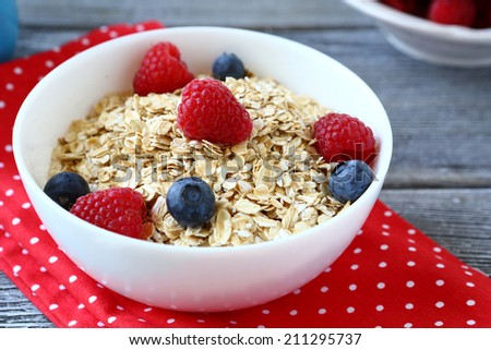 oat flakes with berries, food closeup