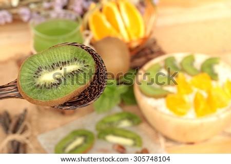 Oat flakes with citrus fruit, kiwi fruit and kiwi juice - stock photo