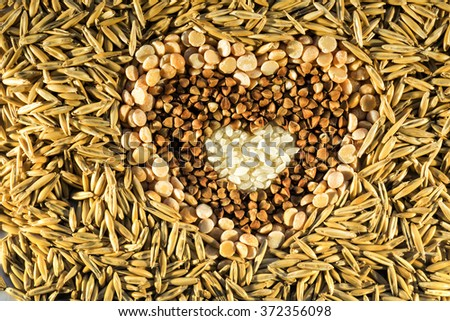 Oat flour healthy eating cereal bowl-shaped heart with wheat shell , forming an abstract background . Figure buckwheat - stock photo