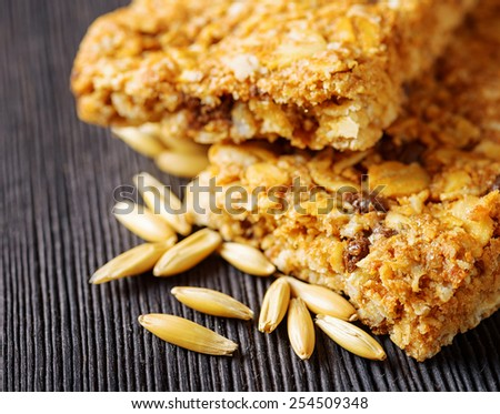 Oat granola bars on a wooden table. Organic healthy food rich in minerals and vitamins. Eco food for breakfast. - stock photo