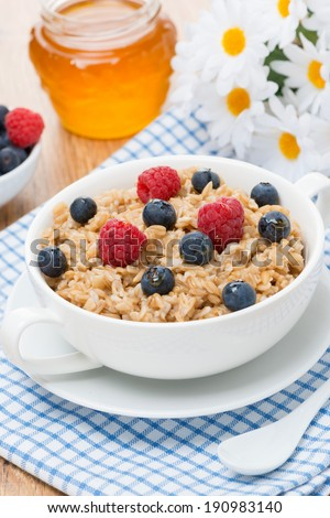oat porridge with berries, vertical, top view