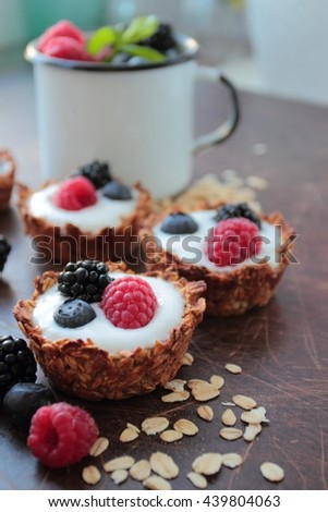 Oat tarts cookies with light yogurt and berries fruits
