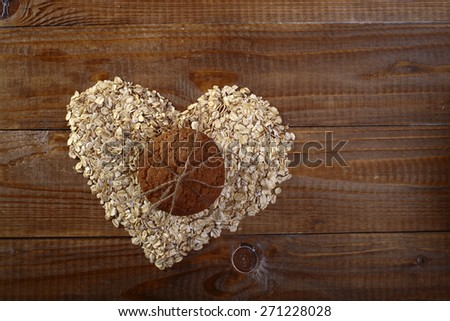 Oatcakes and heart shapes bunting on wooden table top copyspace, horizontal picture - stock photo