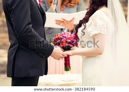 oath of the groom and bride during wedding registration - stock photo