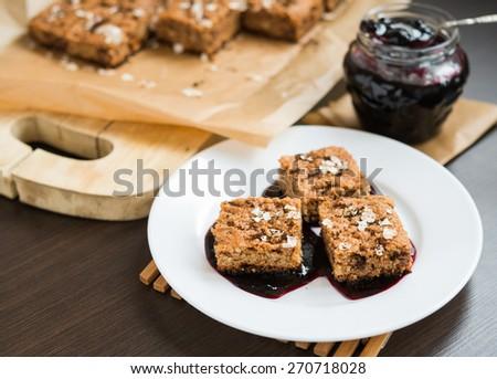 Oatmeal cake with blueberry jam - stock photo
