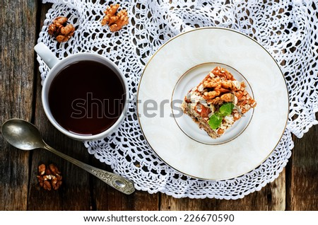 oatmeal cake with dates and walnuts on a dark wood background. tinting. selective focus on mint - stock photo