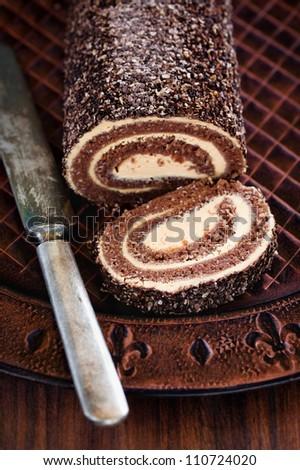 Oatmeal chocolate swiss roll, selective focus - stock photo