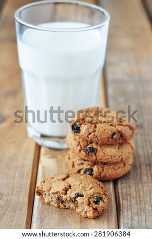 Oatmeal cookie and a glass of milk - stock photo