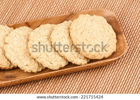 Oatmeal Cookies - A set of fresh, homemade oatmeal cookies on a wooden tray. - stock photo