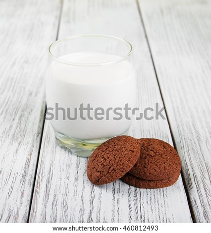 oatmeal cookies and glass of milk on a old wooden table