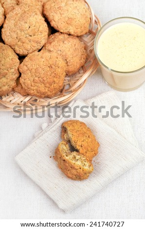 Oatmeal cookies and milkshake on white background, top view