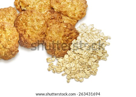 Oatmeal cookies and oat-flakes isolated on white background - stock photo