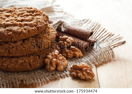 Oatmeal cookies closeup with walnuts and cinnamon - stock photo