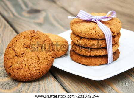 Oatmeal cookies on a old wooden background - stock photo