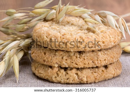 oatmeal cookies, stalks of oats and linen fabric cloth