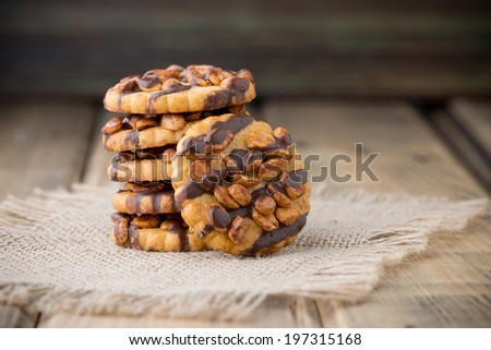 Oatmeal cookies with hazelnuts and chocolate. Studio photography. - stock photo