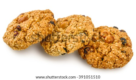 Oatmeal cookies with nuts, sesame seeds and raisins, isolated on white background. - stock photo