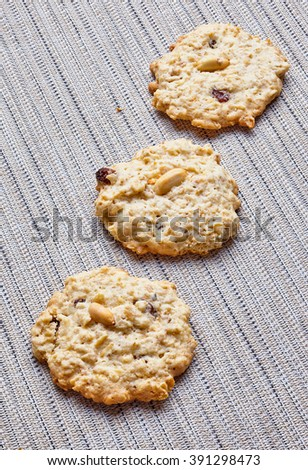 oatmeal cookies with peanuts and raisins on the tablecloth , diagonal composition
