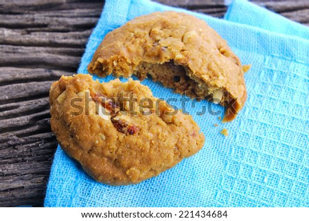 Oatmeal cookies with raisin on a wooden table - stock photo