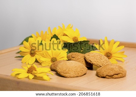 oatmeal cookies with yellow flowers on the table