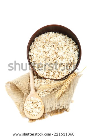 Oatmeal flakes in bowl isolated on white background. Healthy food.  - stock photo