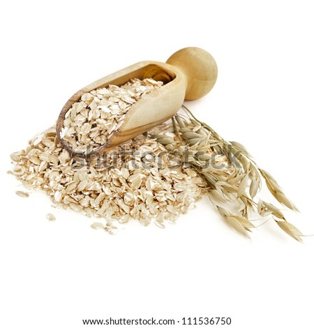 Oatmeal flakes with wooden scoop  isolated on white background - stock photo