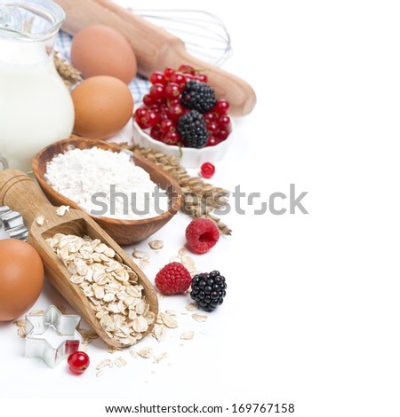 oatmeal, flour, eggs and berries - the ingredients for baking, isolated on white - stock photo