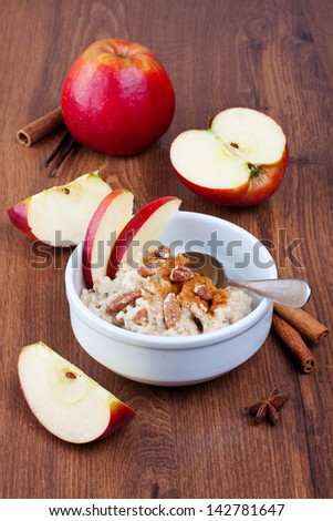 Oatmeal in a bowl with apples and nuts